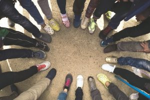 Canva – Top View of Feet of People Standing in a Circle. Runners Standin