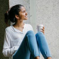 Canva – Woman posing. Wearing White Dress Shirt Sitting on Window (1)
